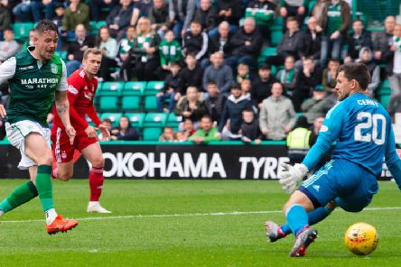 Hibs striker Marc McNulty slots the ball under Tomas Cerny to open the scoring against Aberdeen