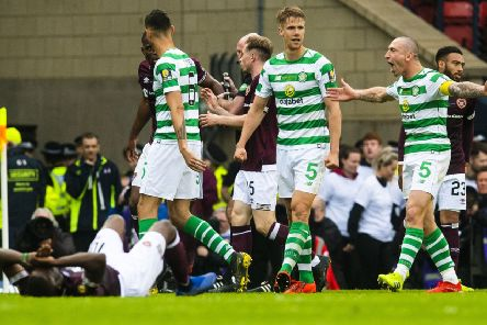 Celtic captain Scott Brown and Uche Ikpeazu collide in the second half. Pic: SNS/Craig Foy
