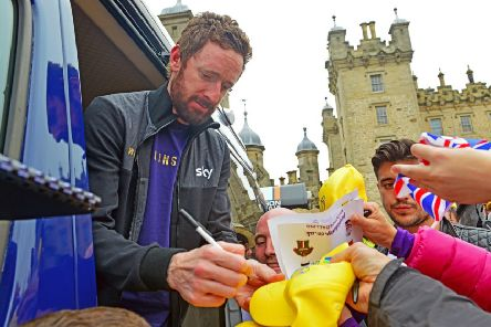 Sir Bradley Wiggins signs autographs at the finish of a stage in the 2015 Tour of Britain at Floors Castle in Kelso (Picture: Ian Georgeson)