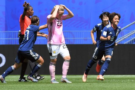 Scotland's Erin Cuthbert shows her frustration after Mana Iwabuchi, right, put Japan ahead in Rennes