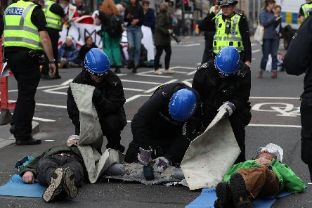 Police had to cut protesters free yesterday.