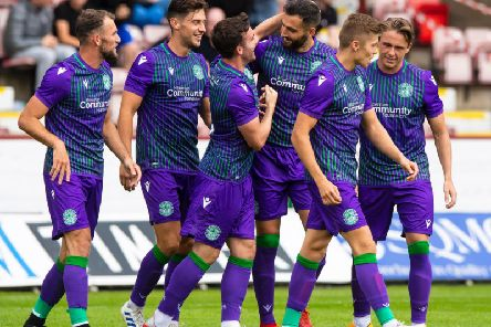 Adam Jackson is congratulated by his team-mates after hauling Hibs level against Dunfermline