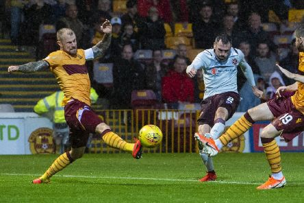 Michael Smith drills the ball home to put Hearts ahead at Fir Park. Pic: SNS