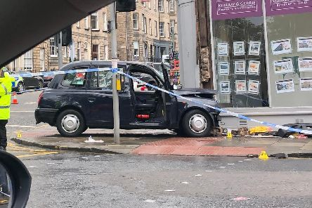 The taxi collided with a pedestrian in Queen Street.
