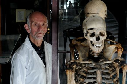 Dr Gordon Findlater of  Edinburgh University's Medical School with masks and the skeleton of William Burke inside the Medical School's Museum.''Pic Neil Hanna