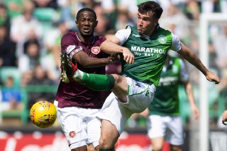 Hibs' Stevie Mallan challenges Hearts' Arnaud Djoum during the last Edinburgh derby. Pic: SNS
