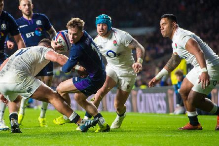 Darcy Graham in action for Scotland against England in the Calcutta Cup match during the 2019 Six Nations tournament