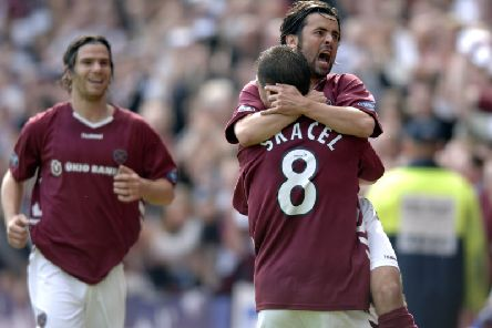 Paul Hartley embraces goalscorer Roman Bednar
