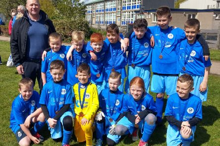 Sponsor Norman Ledingham with the P4/5 team and their new football strips