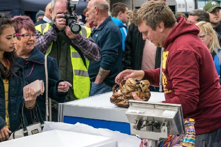 How to handle a crab - just one of the many stalls at last years event.