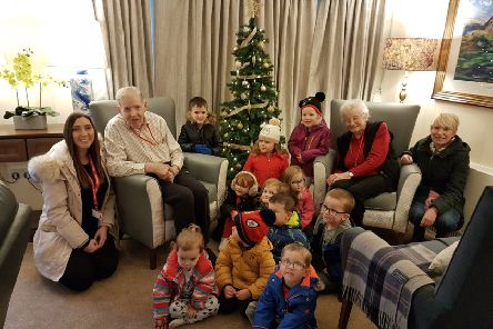 Residents from Auchmacoy Lodge with children and staff from Auchterellon nursery at the event