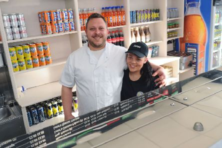 Luca and Lory Fragnoli are now following in the footsteps of chippy owner Enrico Tomassi by running the Main Street shop in Larbert. Picture: Michael Gillen