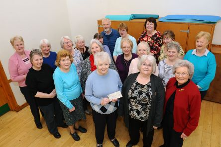Ann Kerr, of MND Association Central Scotland, collects the cheque