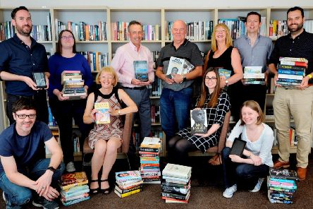 Staff and directors at Palimpsest, including managing director Craig Morrison (third from left in back row), director Ruth Morrison (seated left), director Andy O'Neill (fourth from left in back row), director John Forsyth (sixth from left in back row) and trustee director Sarah Eddie (far right in lower row). Picture: Colin Hattersley