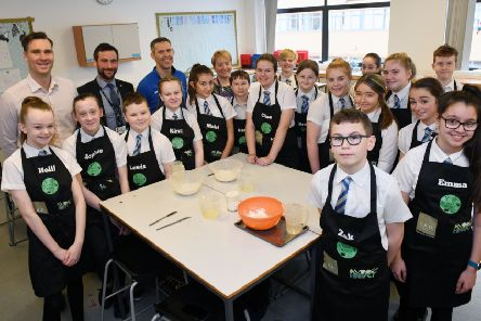 Larbert High S1 pupils with Daniel Bajwoluk, A.D.R. marketing manager; Andy Auld, depute rector; and teachers Brian Townsend and Elizabeth Kirk. Picture: Michael Gillen