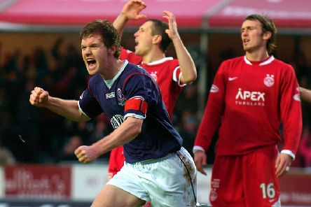 Darren Barr celebrates scoring against Aberdeen in the 2009-10 season as a familiar face looks dejected in the background.