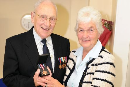 Peter Gray, pictured with wife Isabel, was awarded the Arctic Star Campaign Medal in 2013