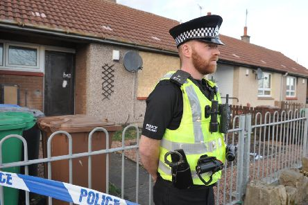 Aan officer stands outside the Alison Street home of murdered Kirkcaldy man Kevin Byrne. (pic George McLuskie).