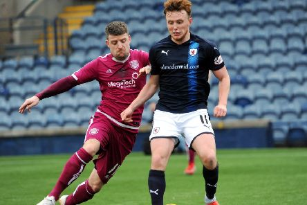 Dingwall vies for the ball with an Arbroath player