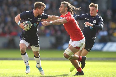 Peter Horne of Scotland is tackled by Josh Navidi of wales during the Guiness 6 Nations match between Scotland and Wales. (Photo by Ian MacNicol/Getty Images)