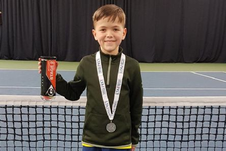 Reian Stewart shows off his medal