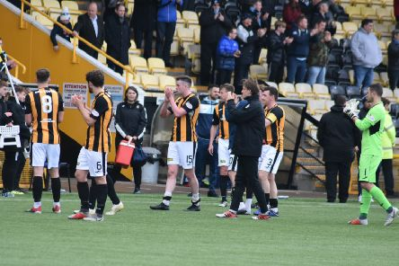 East Fife's players applaud their fans.