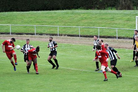 The Newburgh defence defend John Martin's header. Picture by Graham Strachan.