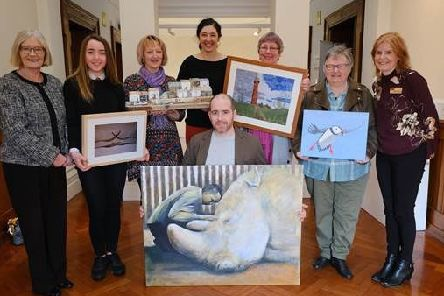 The handover of last year's winning artworks from the Fife Art Exhibition to NHS Fife.
