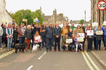 The community council supported a campaign against a housing proposal.