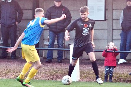 Daryl Falconer keeps the pressure on Craigroyston. Pic by Blair Smith.