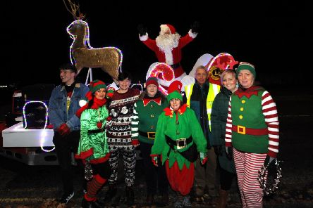 Kirkcaldy and District Lions Club's Santa Sleigh with elves. Pic: Fife Photo Agency.