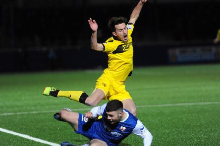 Grant Anderson goes down after a crude challenge by Ballantyne - credit- Fife Photo Agency