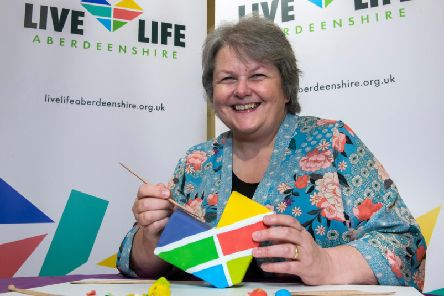 Councillor Anne Stirling practising her Plasticine modelling skills ahead of the animation workshop