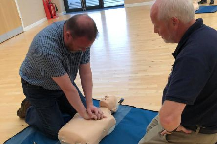 David Duguid undertakes CPR training with the Sandpiper Trust and local ambulance service volunteers