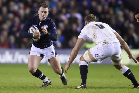 06/02/16. TSPL Shift.  RBS Six Nations Rugby, Calcutta Cup match, Scotland v England, Murrayfield Stadium. Scotland's Stuart Hogg  with England's George Kruis closing in. '' Picture Ian Rutherford