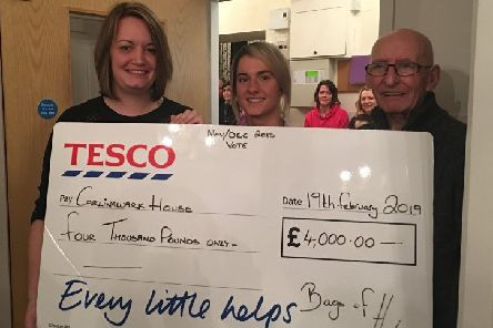 Smiles all round at the presentation of the Tesco donation to the Castle Douglas home.