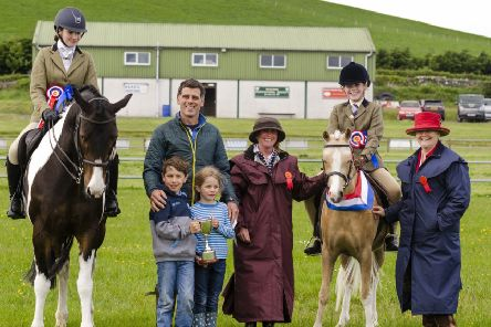 Galloway Pony Club Open Show: Eden McCulloch on Oldlands Last Chance (Reserve Champion); Charlie McNeill (and his children) of Shennanton Sawmill, presenting the Pamela McNeill Trophy; Jan Jardine, Judge; Libby Kay on Griarshill Frederick (Supreme Champion); Tricia Fearn, Judge (Pic by Cameron Anderson Photography).
