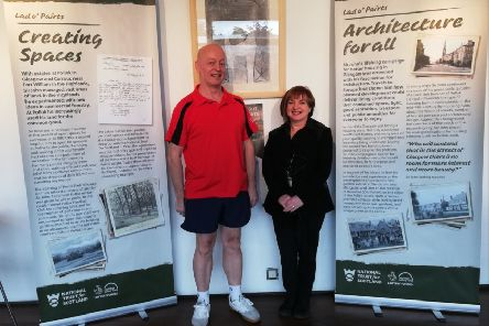 Eastwood Leisure venue assistant Peter Wilson, from Pollok, and customer advisor Sandra Reid, from Erskine, check out the exhibition at Eastwood Park, where it is on display until Thursday, May 23, before moving to Giffnock Library.