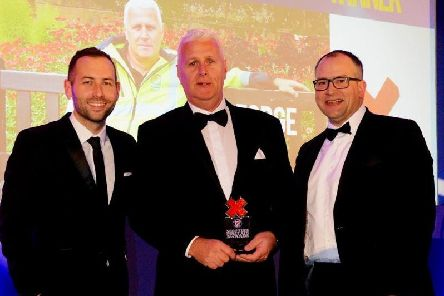 George Duff (centre) is pictured receiving his First Aid Hero of the Year Award.