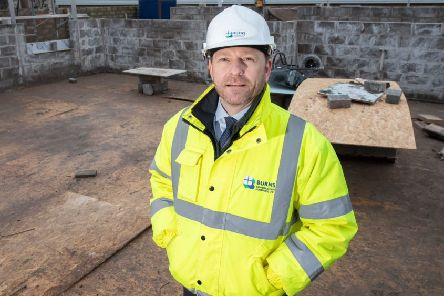 Keith McPhee, of Burns Construction, views progress at the Stonehaven development