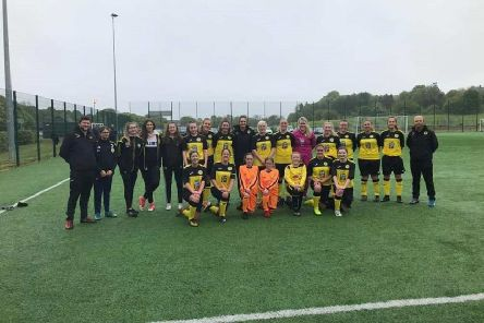 Stonehaven Ladies players and backroom staff line up at Minerallwell last Sunday before the league match against Westdyke Ladies
