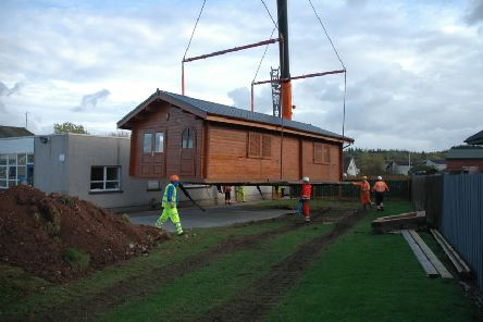 The cabin is lifted into place at Carronhill School. Picture: Aberdeenshire Council