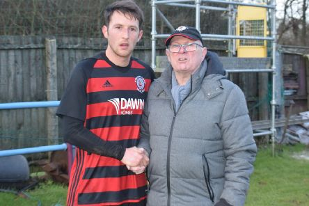 Joe Slattery receives his Man of the Match award, donated by Roddy the Dog Walker, from sponsor Charlie O'Brien after Saturday's game.