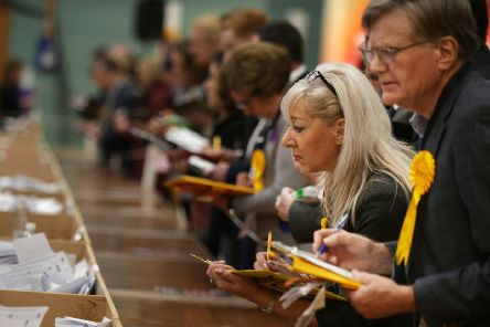 BEARSDEN, SCOTLAND - DECEMBER 12: Volunteers observe the ballot count from the UK general election in East Dunbartonshire on December 12, 2019 in Bearsden, Scotland. East Dunbartonshire is the seat held by Liberal Democrat Leader Jo Swinson. Current Prime Minister Boris Johnson called the first UK winter election for nearly a century in an attempt to gain a majority to break the parliamentary deadlock over Brexit.  The election results from across the country are being counted overnight and an overall result is expected in the early hours of Friday morning. (Photo by David Cheskin/Getty Images)