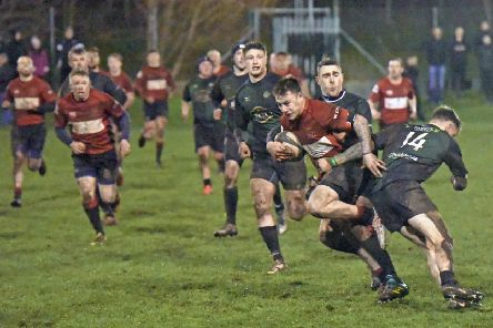 Linlithgow's Cammy Walker attempts to break through the Forrester defence (pic by Graham Black)
