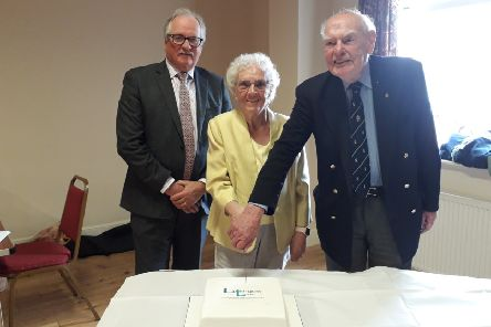 Linlithgow Link's 40th anniversary celebration. Cutting the cake from left to right are George McNeill vice Lord Lieutenant, Thelma Napier and David Morrison.