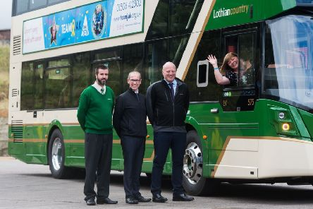 Lothiancountry's driver Lee Sutherland, garage manager Craig McCafferty and managing director Richard Hall with Alison Barr of Team Jax. Pic: Wullie Marr Photography