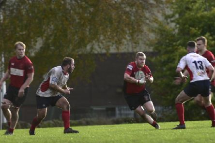 Reds star Russell Murdoch is pictured weaving his way through the Haddington lines (Pic by Graham Black)