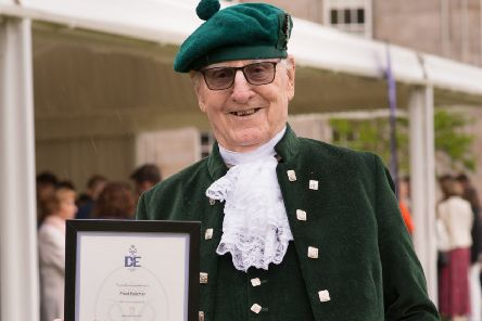 Fred Belcher, from Portlethen, with his long service certificate