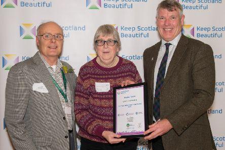 Brighter Bervie representatives Tom Campbell, left, and Mary Finch receive the award